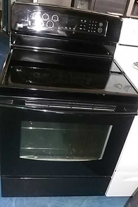 LG black smooth top stove with 90 days warranty