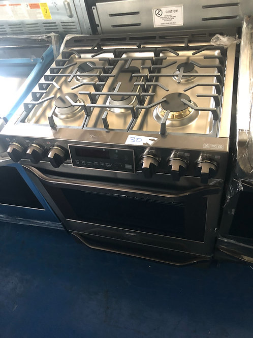 Brand new scratch and dent black stainless slide in electric stove  1 year warra