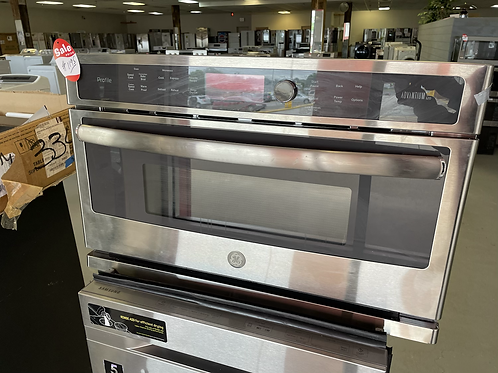 """Ge profile new open box 30"""" Built in Microwave stainless steel."""
