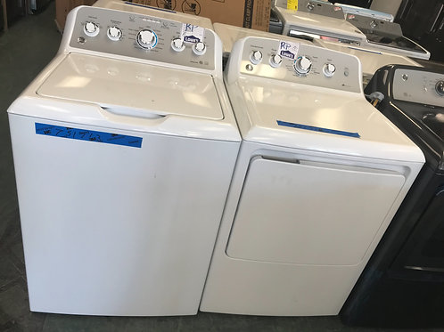 Ge brand new open box top load washer dryer set with warranty.