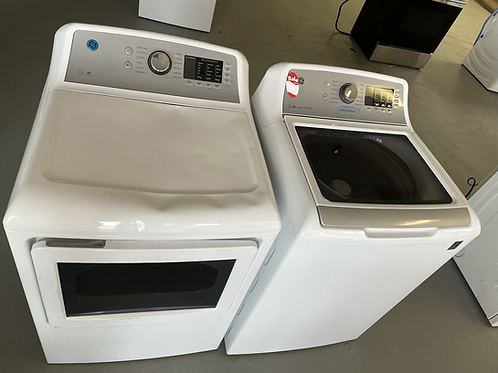 """Ge new open box scratch and dent top load washer dryer set 27""""."""