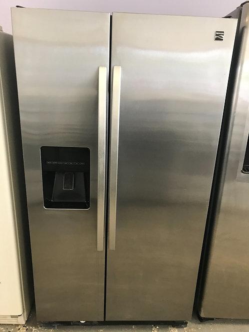 Kenmore Brand refurbished stainless steel side by side refrigerator.