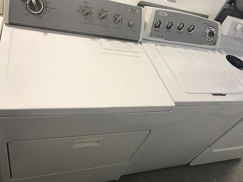 Whirlpool brand refurbished top load washer dryer set.