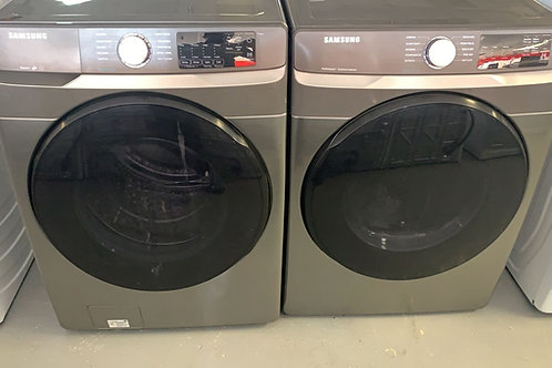 Samsung new slate Stackable washer dryer set With 1 year warranty.