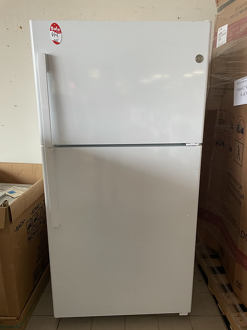 "Ge new open box 33"" Top freezer refrigerator with 90 days warranty."