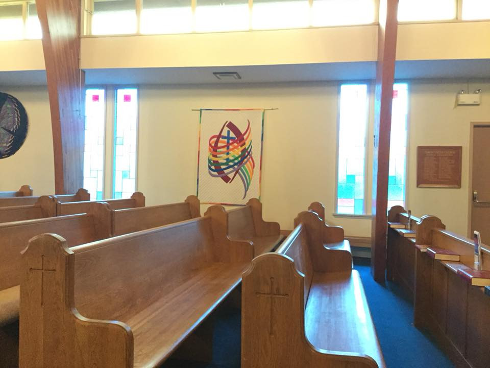 Affirming banner quilt in the sanctuary at comox united church