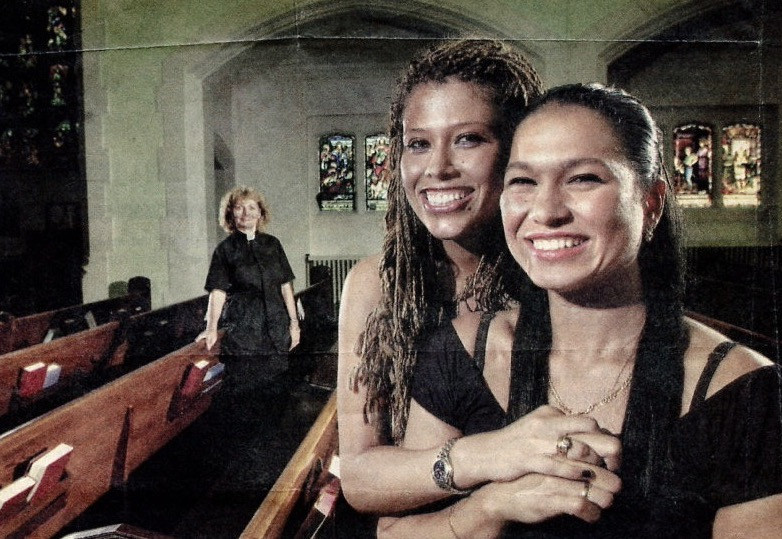 two married women in church with minister