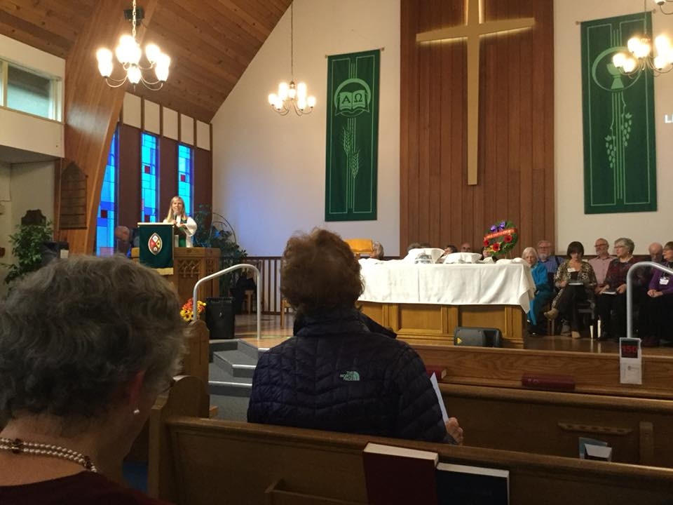 the minister speaking at comox united church