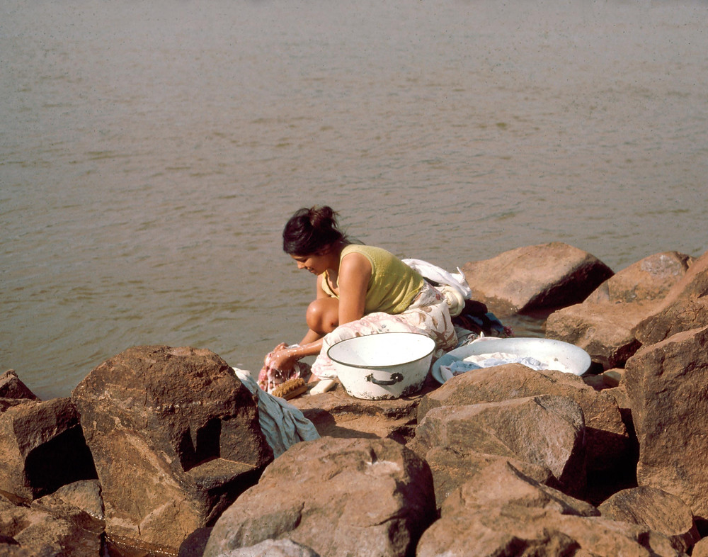Washing clothes by the river in Paraguay (Courtesy U.S. Peace Corps)