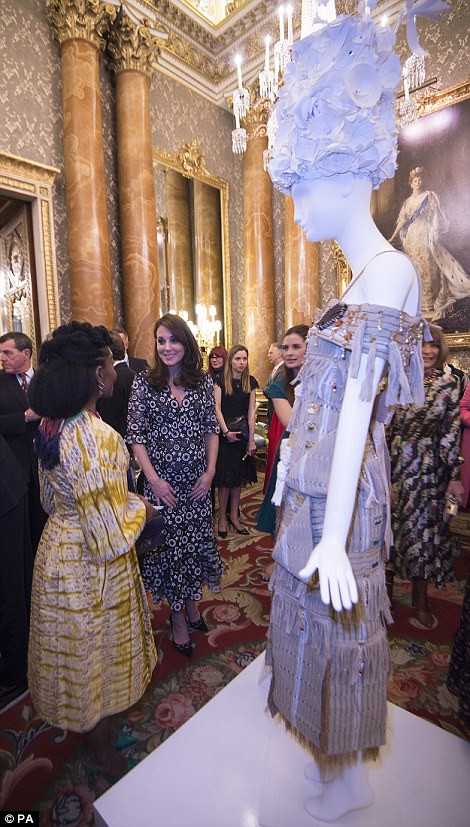 The Duchess chats with Nkwo about her beaded design (on mannequin)