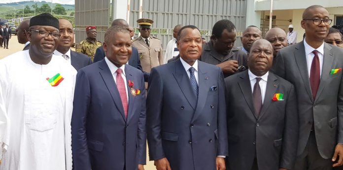 Founder, Dangote Group of Companies, Alhaji Aliko Dangote (2nd Right) flanked by DRC's President Denis Sassou Ngesso (R) and Nigeria's Minister of Solid Minerals Development, Kayode Fayemi (L)