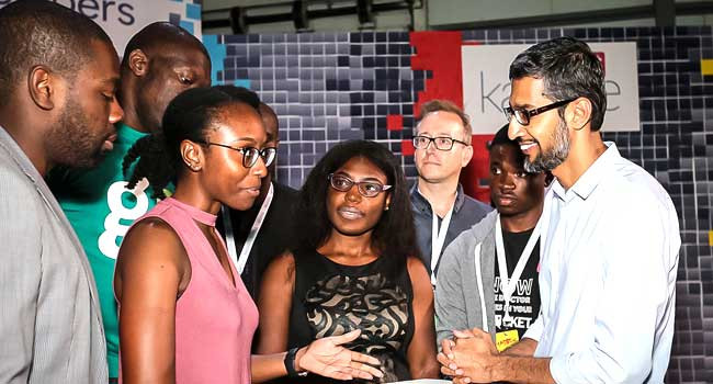 Google CEO, Sunday Pichai (R) meets Nigerians during a recent trip to the country