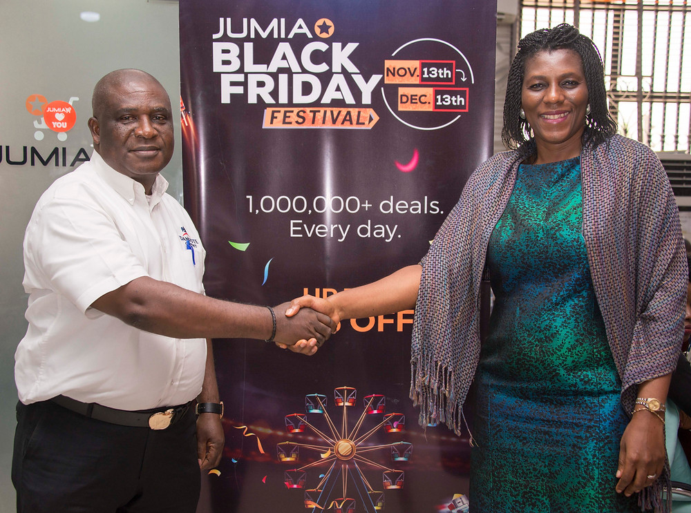 (L-R) Chux Mogolu (Key Account Director, Dangote Cement) in a handshake with Juliet Anammah (CEO, Jumia Nigeria)