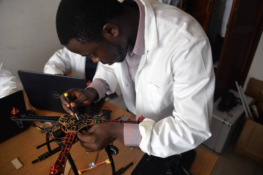 A Cameroonian engineer from the Will & Brothers startup works on a drone at a workshop in Douala on Feb. 16. | AFP-JIJI