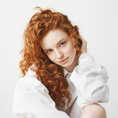 Portrait of cute tender ginger girl with