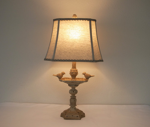 Natural linen birds sink table lamp home lighting el monte city this elegant table lamp features two birds perched on a sink design base an antique cream white finish base is complemented by a rectangle lace trimming mozeypictures Images