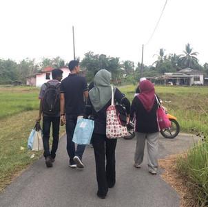 Quantitive team on their way to door-to-door visit in rural Kelantan
