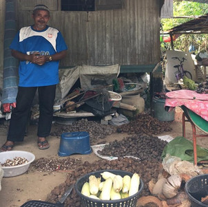 A village chief poses with local products