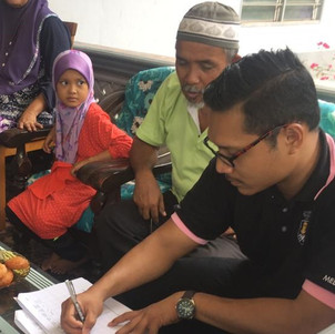 Rifqi taking note on participant's medications