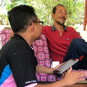 Rifqi interviewing a participant