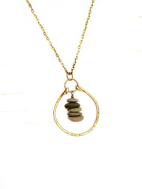 Hammered brass necklace with stone cairn