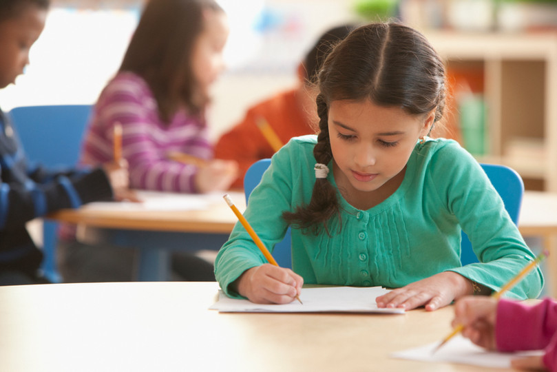 A Girl in a Classroom writing