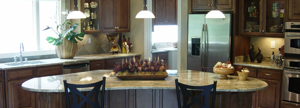 A Kitchen that is filled with natural light is a beacon for energy and the rounded island welcomes anyone for a seat.