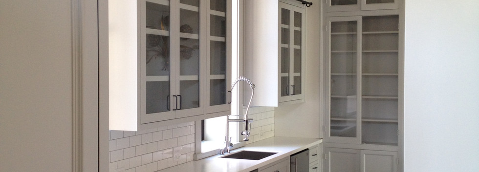 A Butler's Pantry that has abundant glassware storage with a ladder sytem for those extra high custom cabinets.