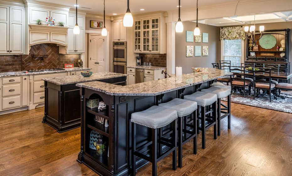 A more traditional Kitchen that adorns two islands for the growing family or entertaining a house full of guests.