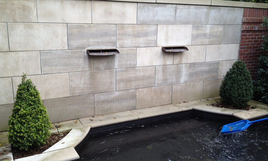 Custom waterfall wall into this homeowner's pond needed some attention.  It looks and works much better now.  Also, there is something soothing about water sounds into a pond area.