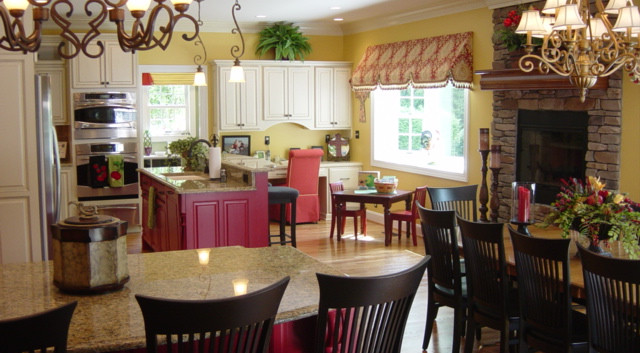 Needing room for a huge family and two tables, we added on to this home to accomodate a large Kitchen and hearth area.  The grandchildren popped with excitement when they saw the red islands and small kid table just their size.