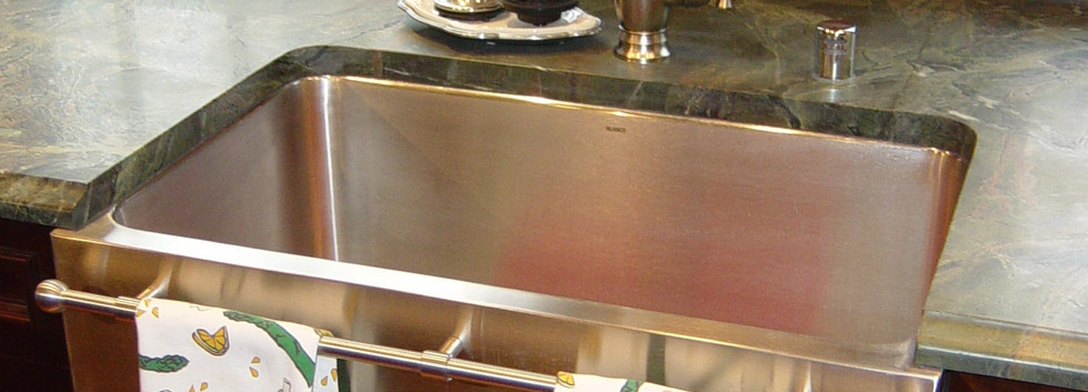 Beautiful stainless farm sink with built-in towel racks assist any chef in the kitchen.