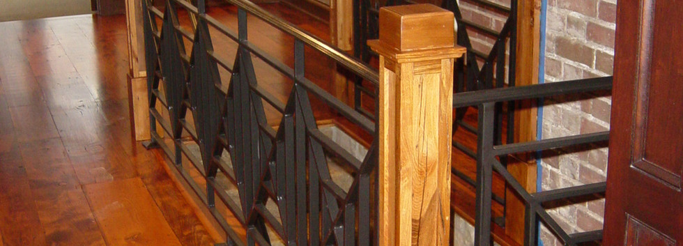 Custom iron railings on this staricase are a beautiful addition.