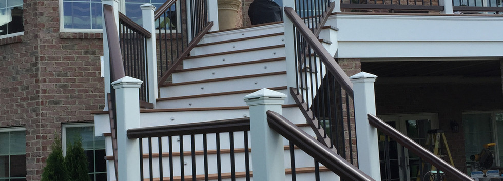 Intricate plans were made to construct this exterior Trex staircase down to the patio.  Our trim carpenters were put to the test due to all of the details involved.