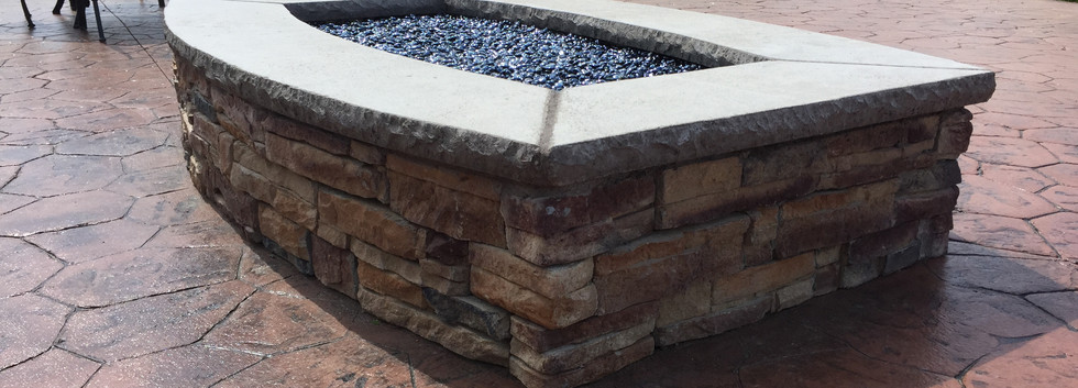 A custom designed firepit for this homeowner who is not a fan of straight lines.