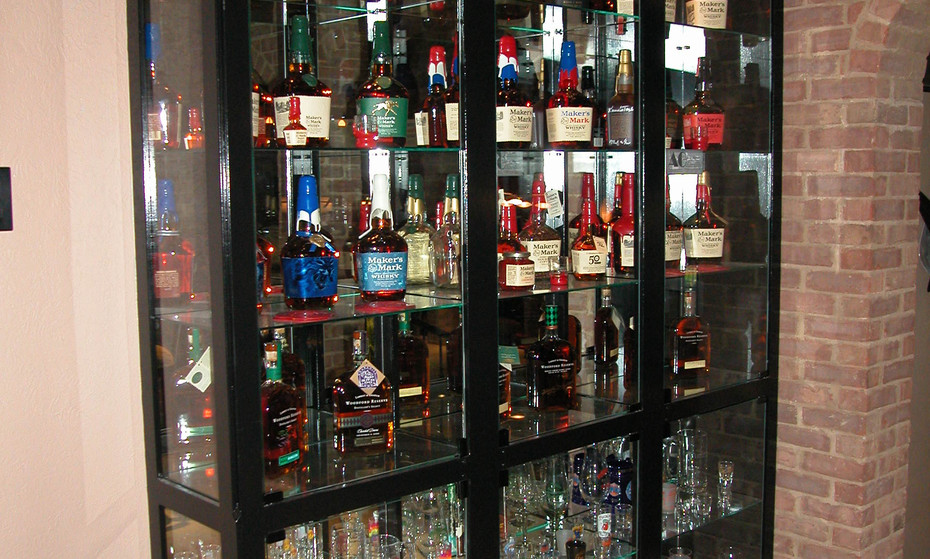 A celebration of bourbon in Kentucky in a custom glass case in this lower level.  Yum!