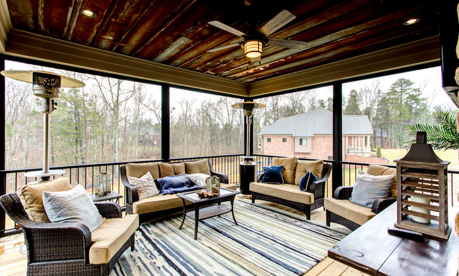 Screened in deck with reclaimed barn roofing installed on the ceiling is one modernly rustic area.