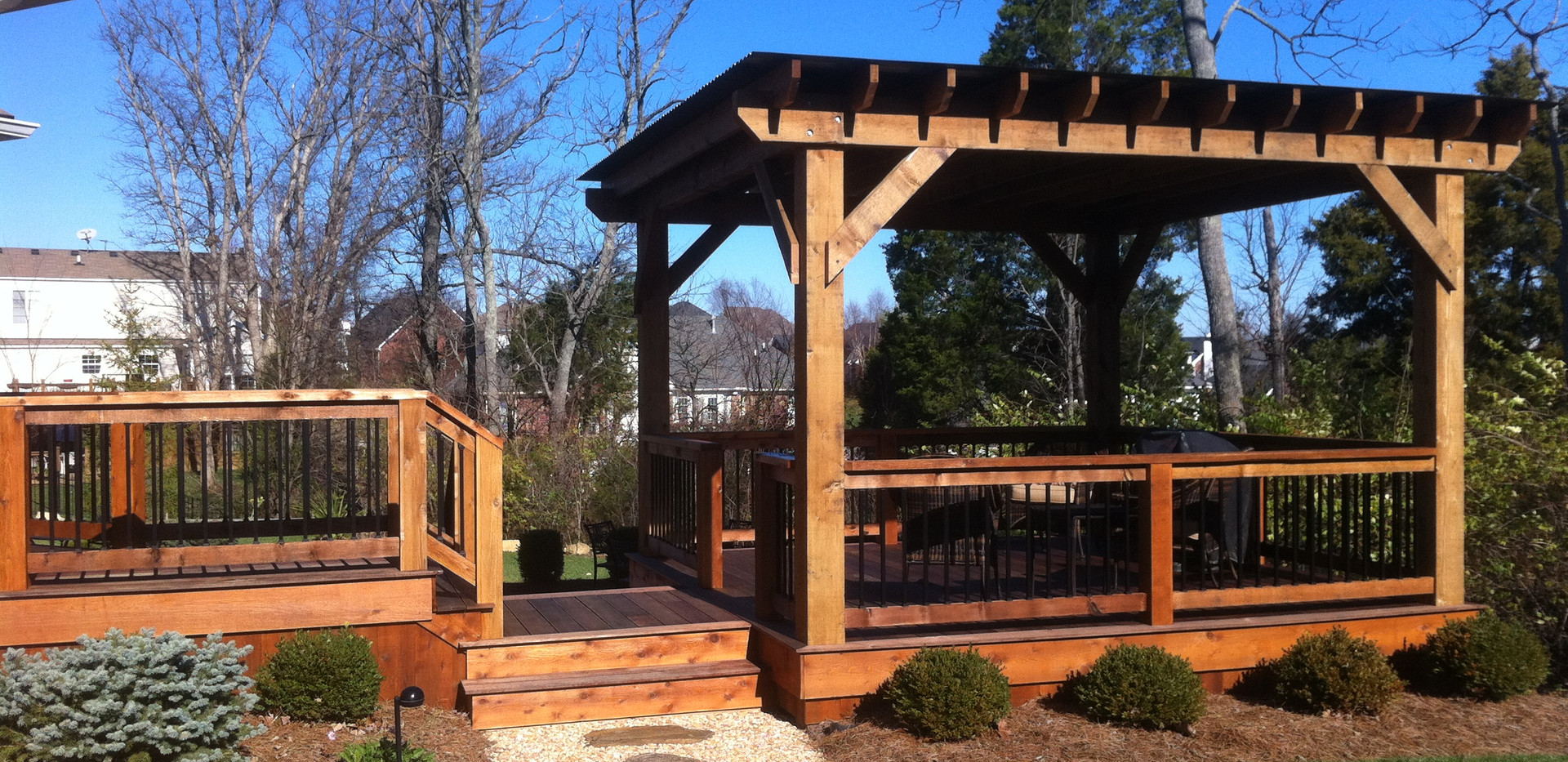 A custom built cedar pergola with metal roof is perfect for entertaining.