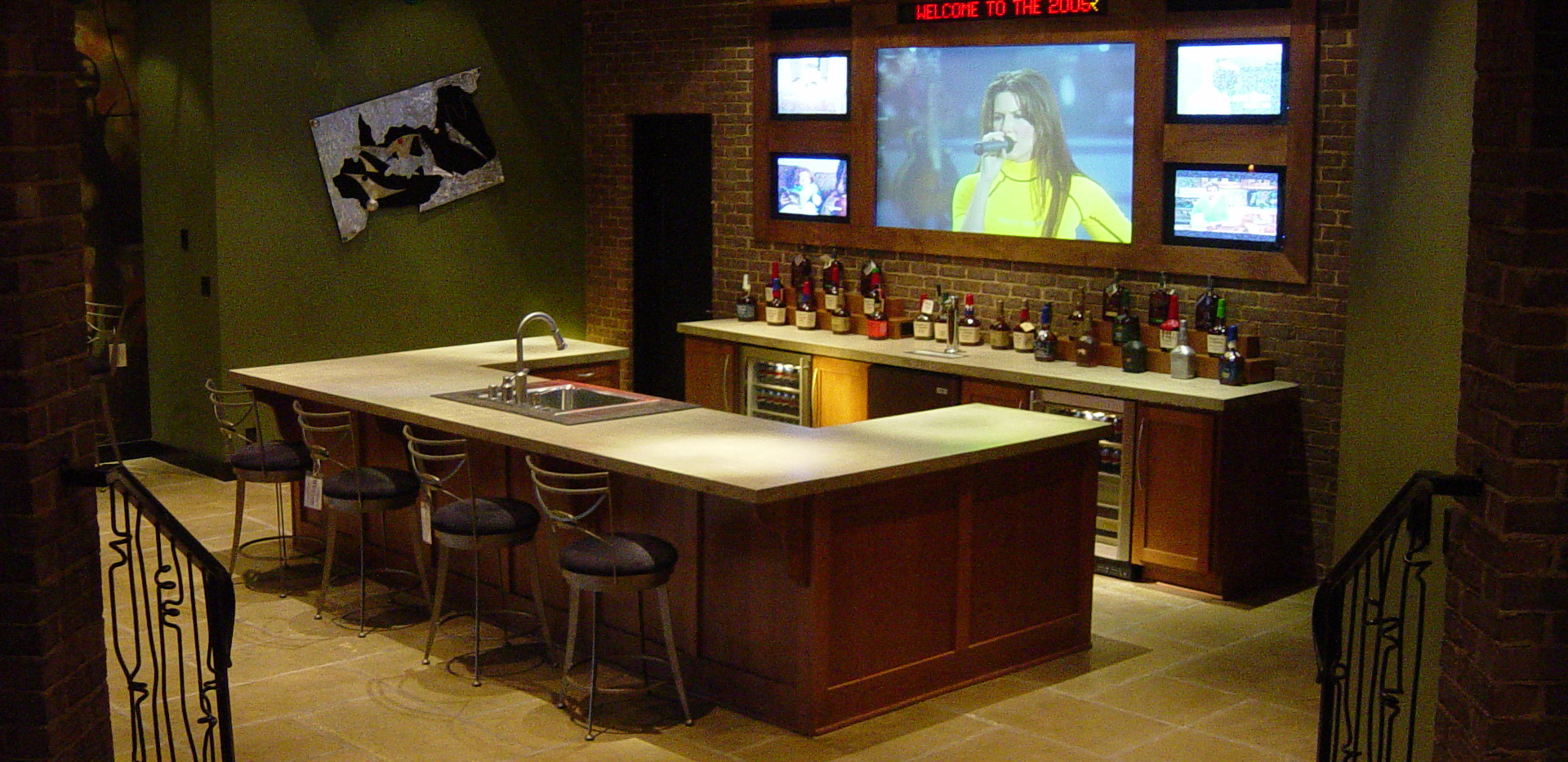 The ultimate basement with rear projection main screen, four other televisions for the perfect sports bar atmosphere.  Concrete countertops, beverage centers, kegerator and more make this THE place to hang out.