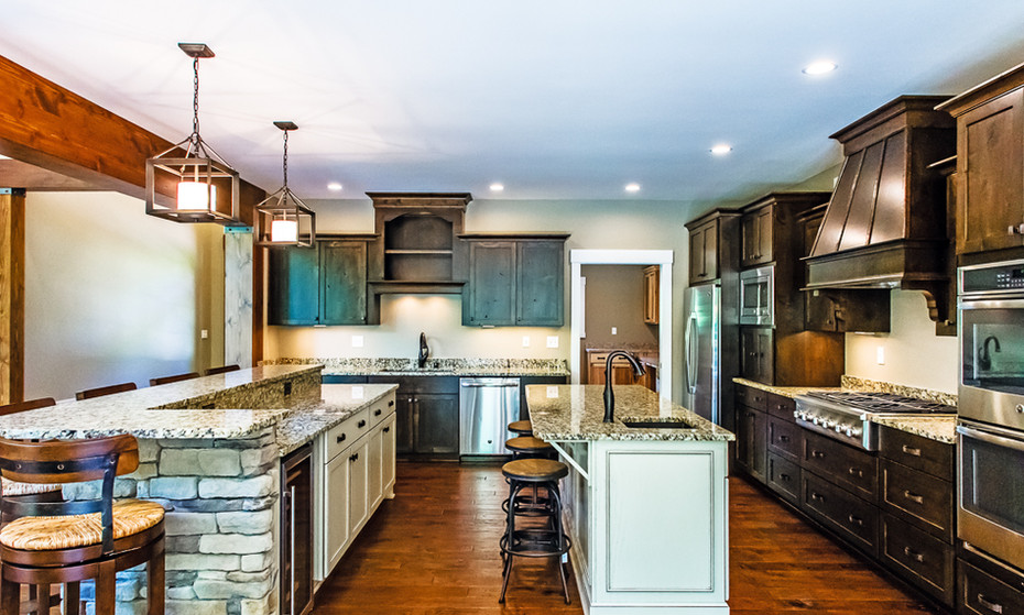 Side view of the same kitchen shown before.  These two islands give room for plenty of entertaining and cookie making.