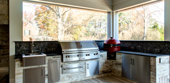 A custom outdoor Kitchen anyone would love that is equipped with a gas grill, smoker, beverage sink, granite countertop, pull out trash, storage access doors and dry pantry.