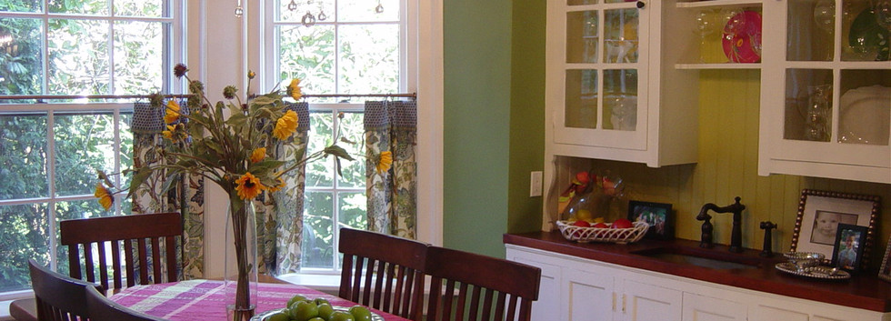 Even in a small space you can add spunk to a Kitchen with some color!  Using the existing buffet in this house but changing everything around it added to this eat-in area.