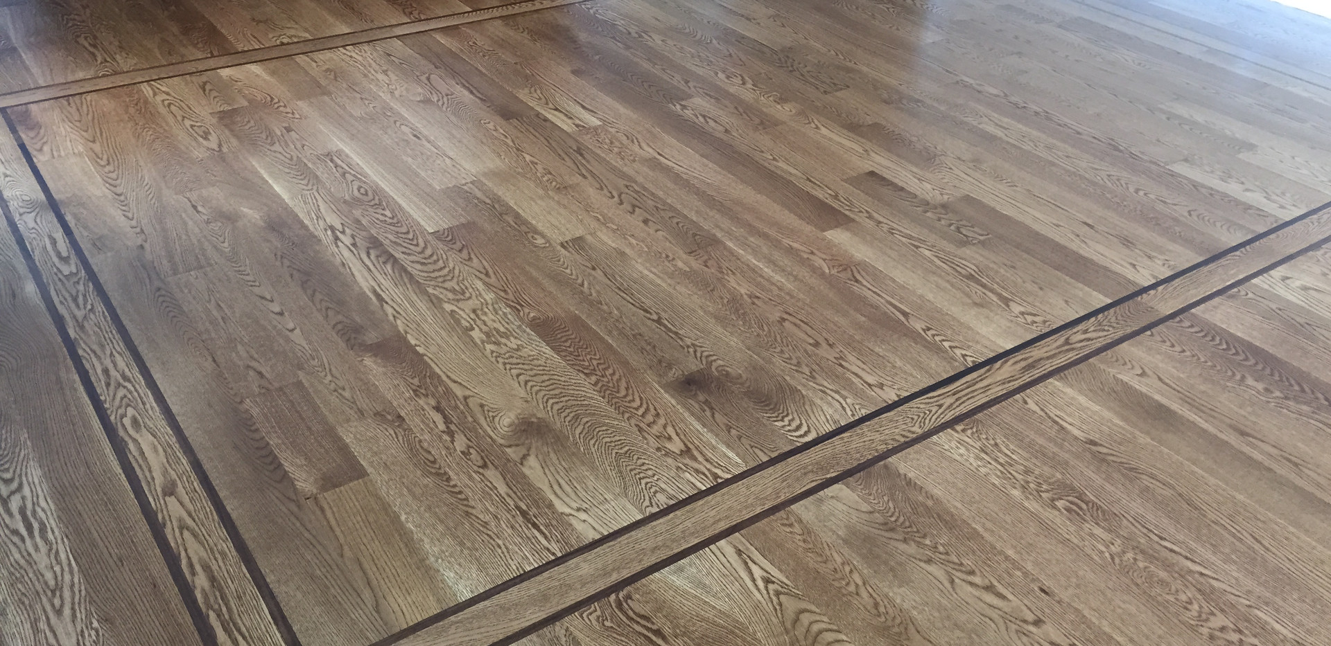 Add a bit more interest to your hardwood flooring by adding an inset border.