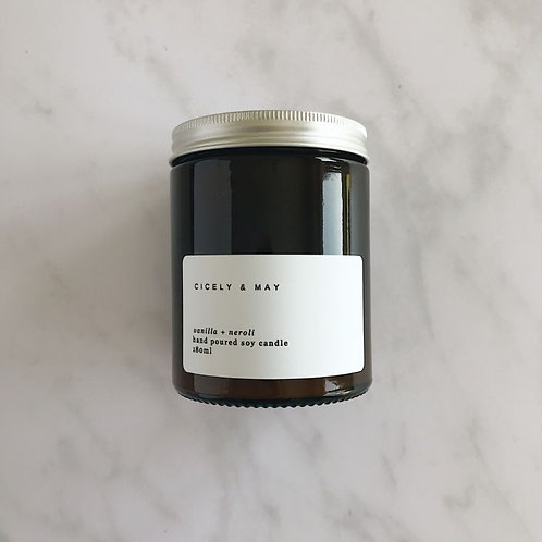 Glass Jar candle with white label and alluminum lid.