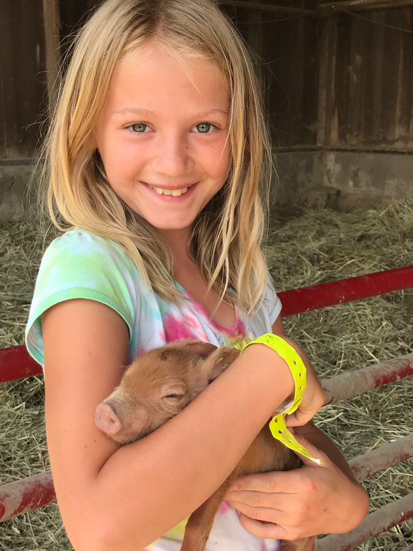 Evelyn Holding Baby Pig