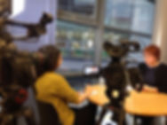 Journalist interviewing on camera
