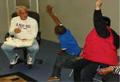 Ron Glass and kids in Storybook Theater.