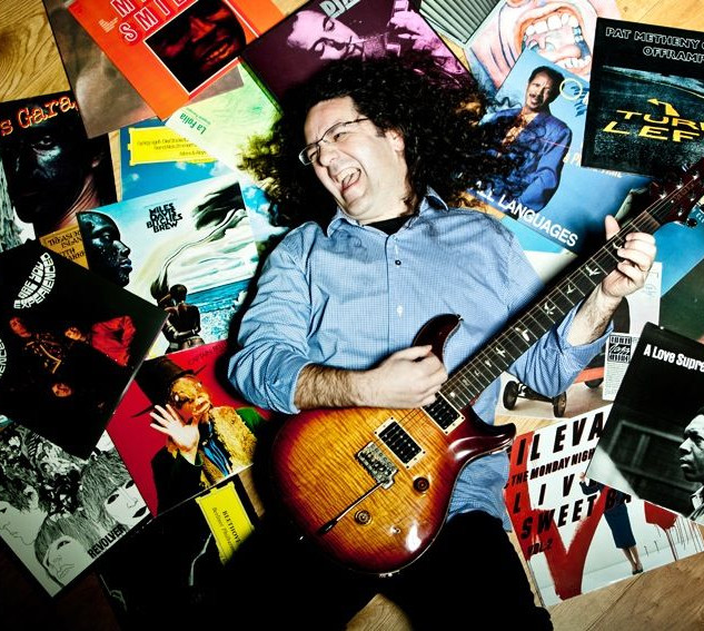 Enrico Merlin with guitar & records.jpg
