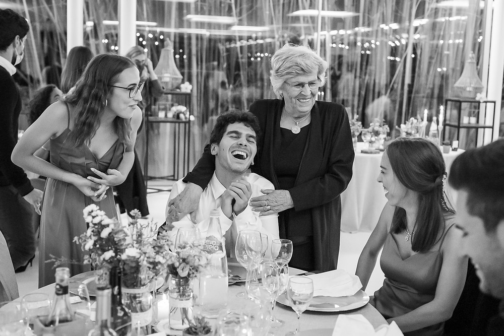 grandma with grandchildren laughing