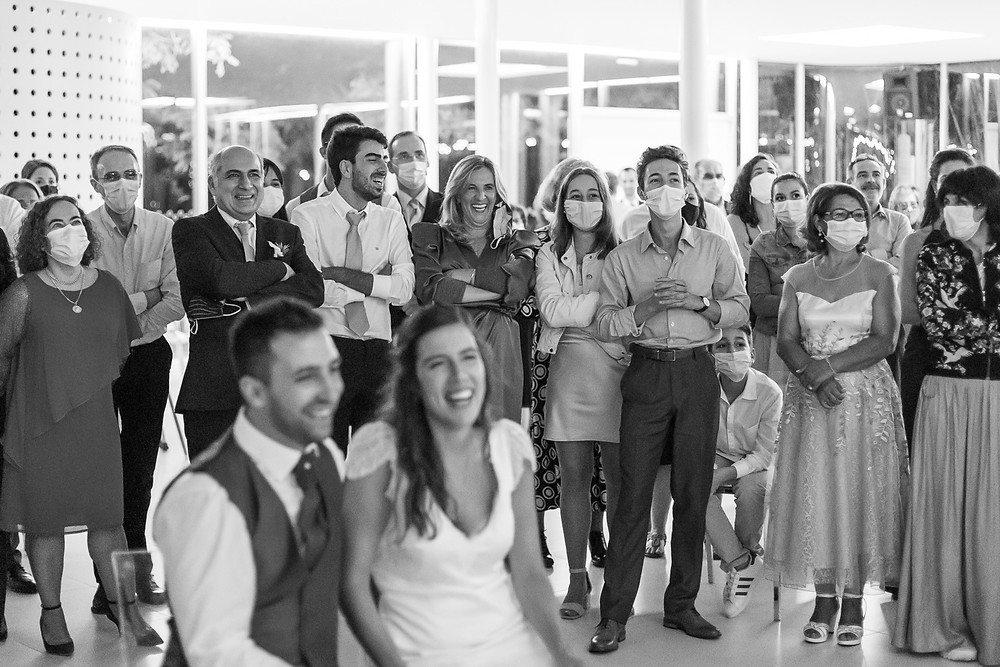 Guests enjoy video of bride and groom